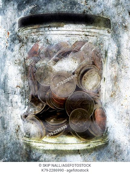 Coins in a jar appear to be encased in ice