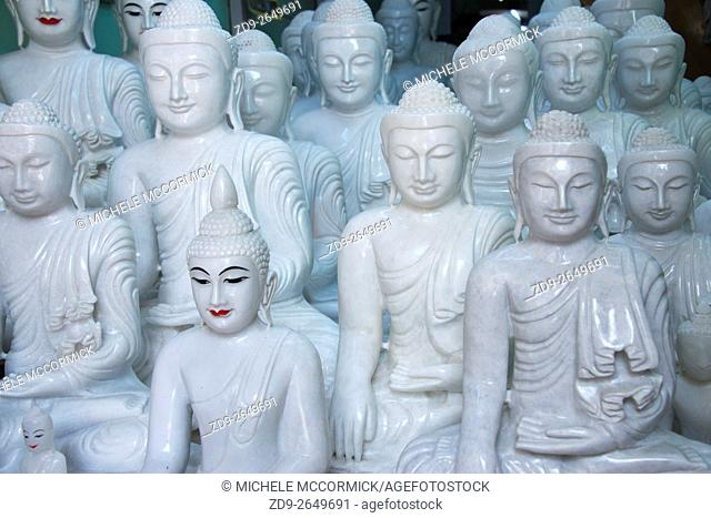 Statues of buddha for sale in shops along the road near Mandalay