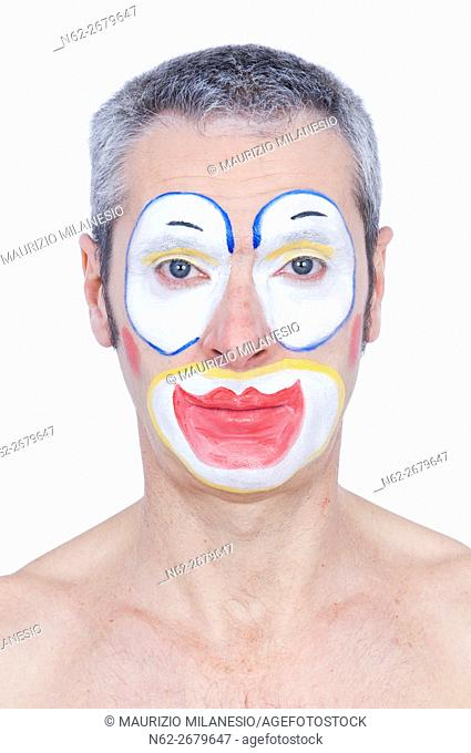 Portrait of a serious clown shirtless front view