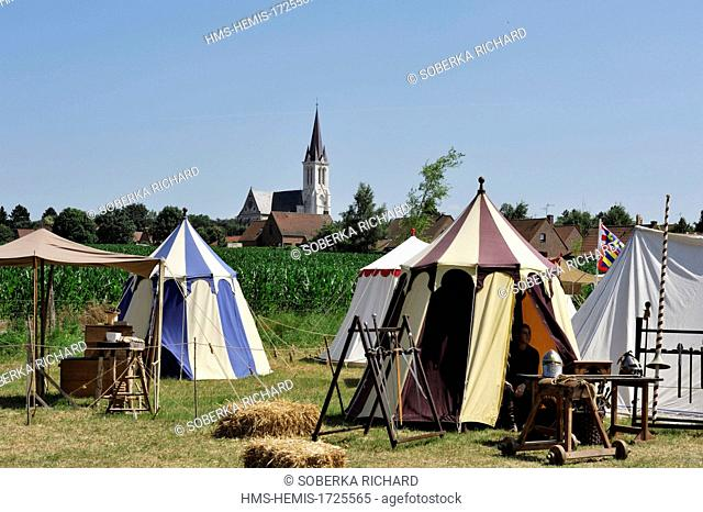 France, Nord, Bouvines, Medieval Festival of Bouvines 2013, reconstruction of a camp with tents pitched in a meadow in front of the church