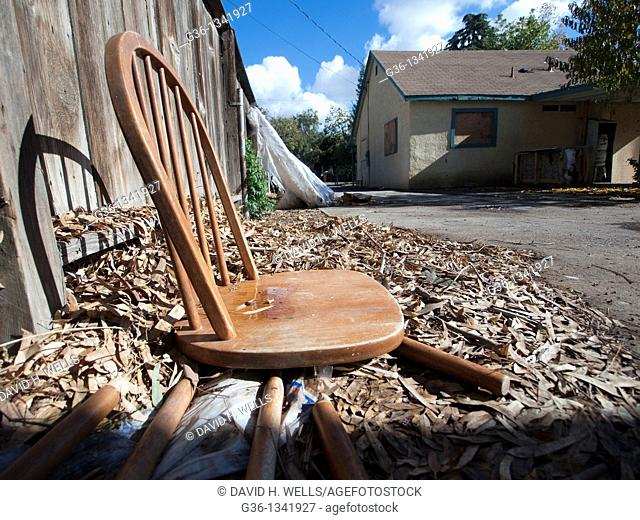 A collapsed chair in the backyard of a foreclosed house in Fresno, California, United states