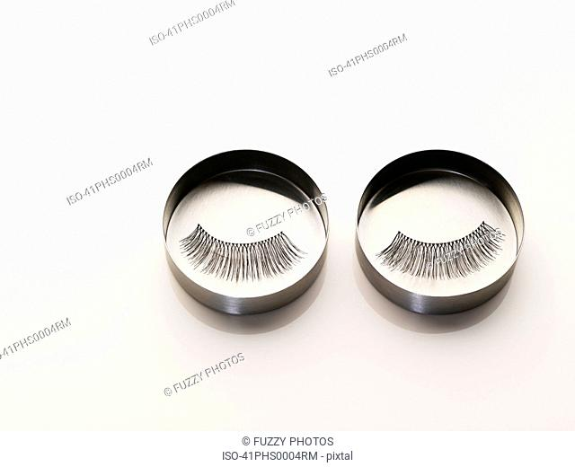 Close up of false eyelashes in tin