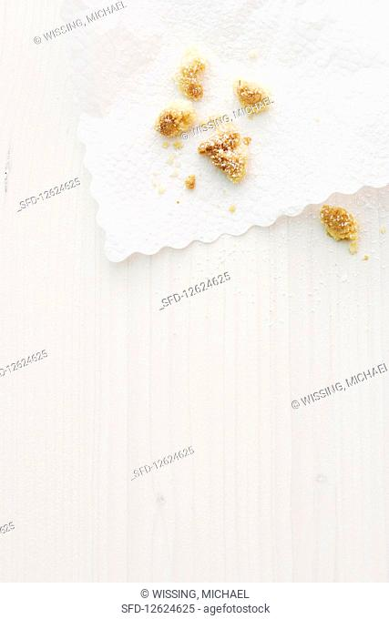 Remains of crumble cake on a paper napkin