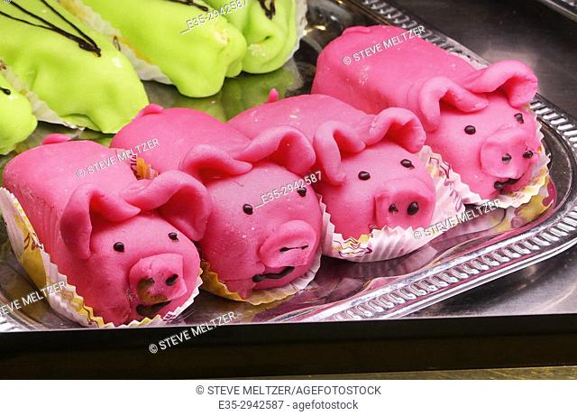 Marizpan pastry pigs in a shop window in Narbonne, France