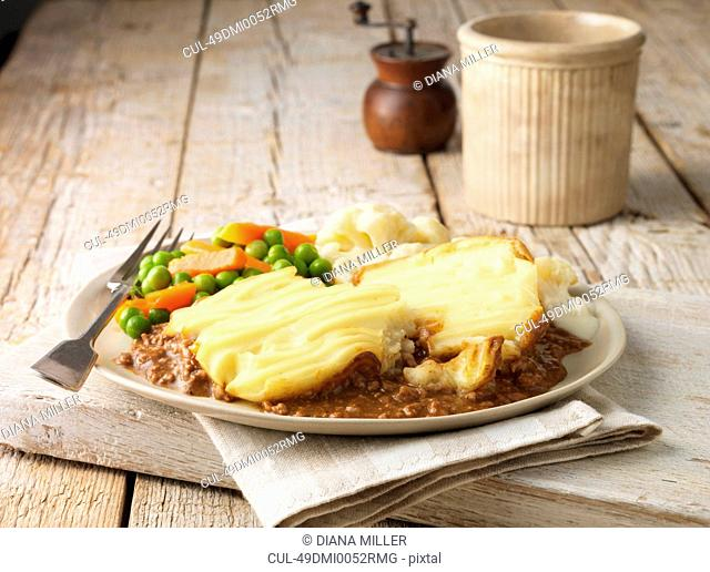 Plate of cottage pie with vegetables