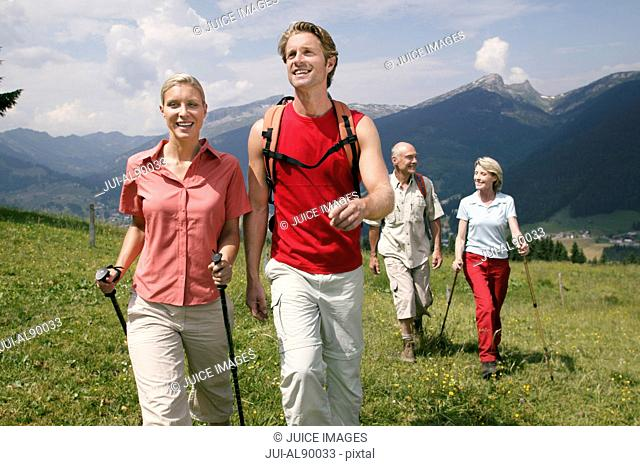 Two couples hiking, Kleinwalsertal, Allgau, Germany
