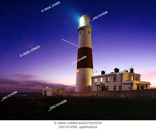 Portland Bill lighthouse at dusk on the Dorset Jurassic Coast, England, United Kingdom  The planet Venus is seen traversing the night sky during a 1 hour long...
