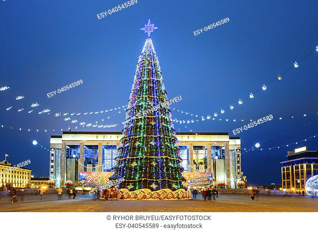 Christmas tree, illuminations and decorations in front of building of the Palace of Republic in Oktyabrskaya Square - famous place in central Minsk, Belarus