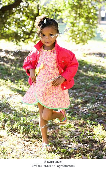 Portrait of African American girl in park