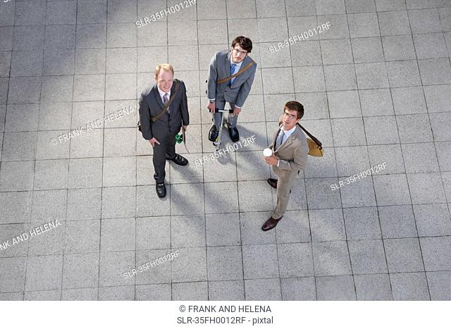 Business people talking in courtyard