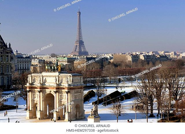 France, Paris, Tuileries gardens under the snow, the Carrousel arch and the Eiffel tower