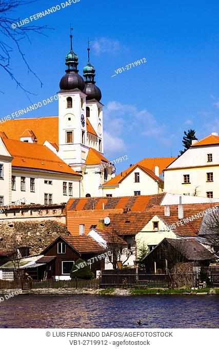 Holy Name of Jesus Church and surrounding houses by the medieval fishpond. Telch, Czech Republic