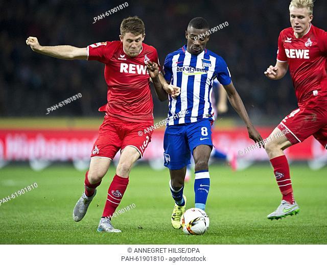 Hertha's Salomon Kalou (R)and Koeln's Dominique Heintz vie for the ball during the German Bundesliga soccer match between Hertha BSCand 1