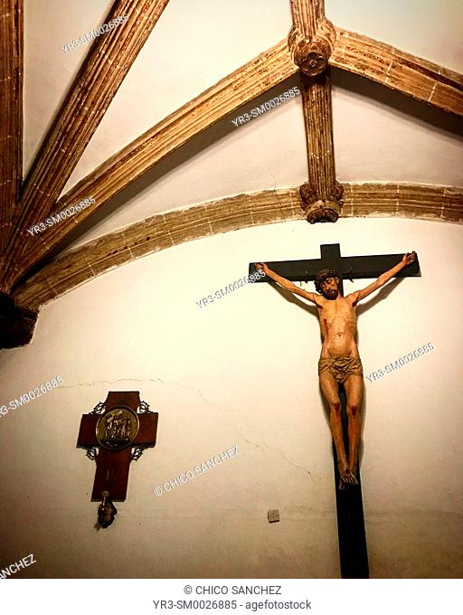 A sculpture of Jesus Christ crucified decorates a church in Caceres, Extremadura, Spain