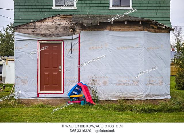 Canada, Prince Edward Island, Georgetown, house under cosnstruction with plastic children's toys