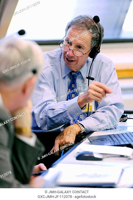 NASA Administrator Michael Griffin talks with JSC Director Michael Coats and other NASA managers in the Launch Control Center prior to the launch of the Space...
