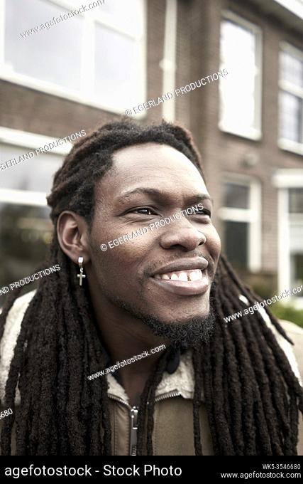 African man feeling happy in Leeuwarden, Friesland, Netherlands, Europe