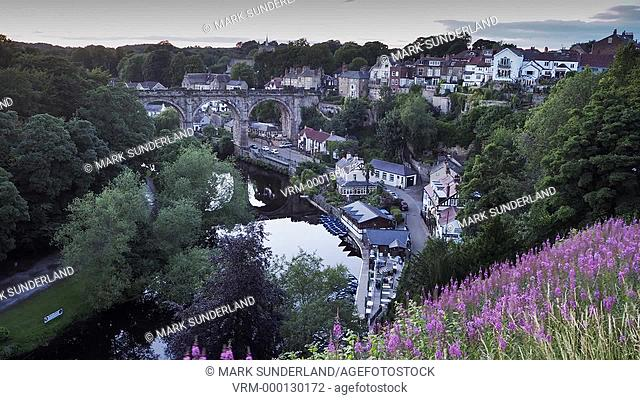 Timelapse of Knaresborough viaduct and the River Nidd at dusk as the lights are coming on North Yorkshire England