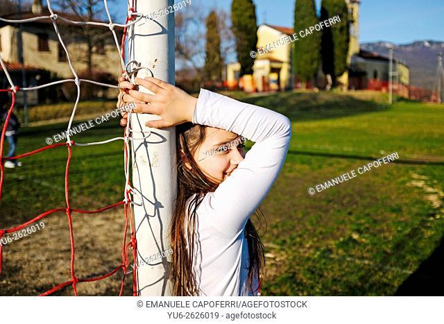 Girl in soccer goal