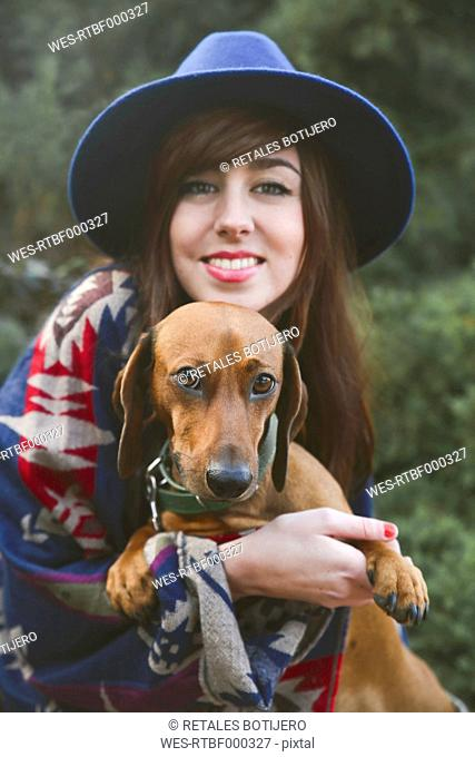 Portrait of happy woman with her dachshund
