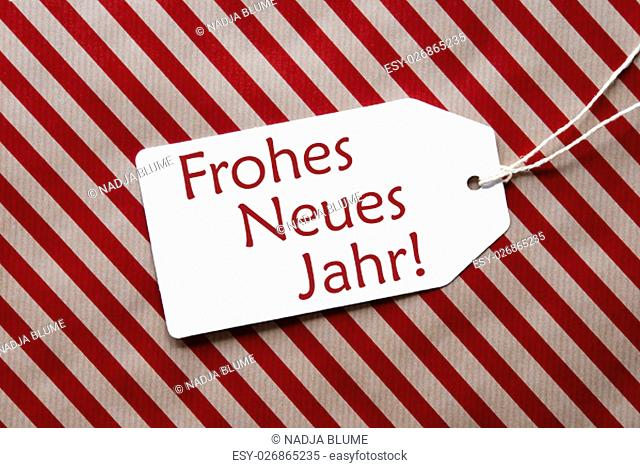 One Label On A Red And Brown Striped Wrapping Paper. Textured Background. Tag With Ribbon. German Text Frohes Neues Jahr Means Happy New Year