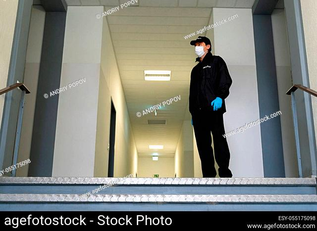 Security Guard In Face Mask At Entrance