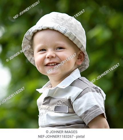 Boy wearing cap smiling to camera