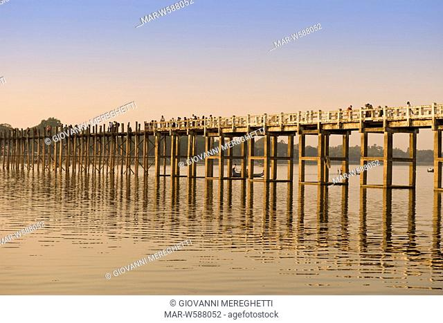 footbridge ubein teakwood, connects amarapura to a pagoda on the other side of the lake, myanmar