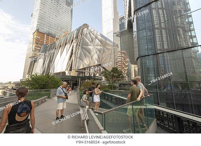 """Tourists on the High Line amidst development in and around Hudson Yards, including """"""""The Vessel"""""""" and Tthe Shed"""""""", left, in New York on Saturday, September 1"""