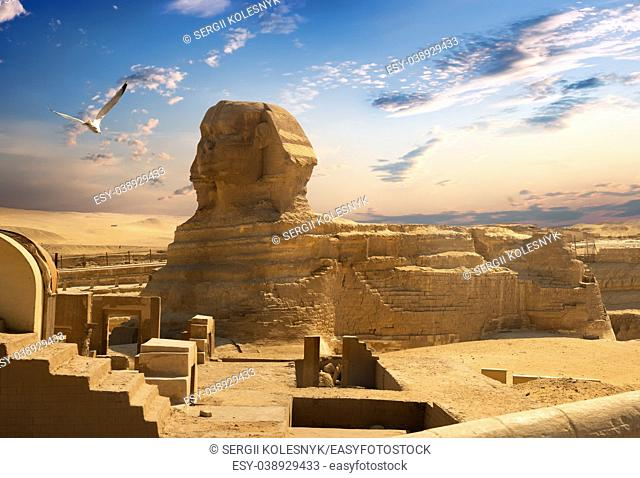 Sphinx and pyramid in the egyptian desert