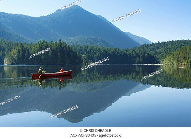 Canoe fishing on Klein Lake near Egmont, , Sunshine Coast, British Columbia, CanadaBritish Columbia, Canada