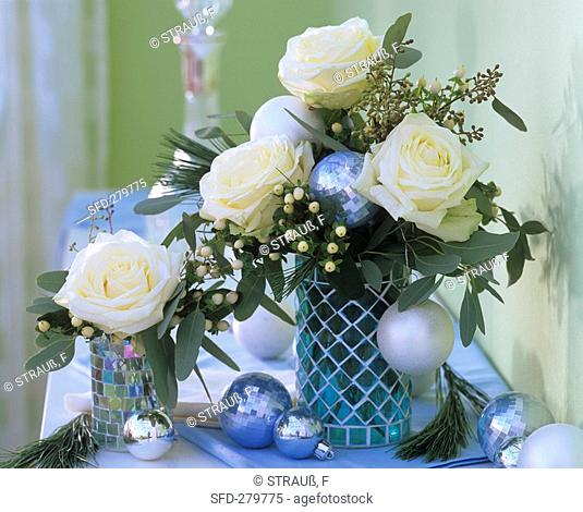 Arrangement of white roses, eucalyptus & Christmas baubles