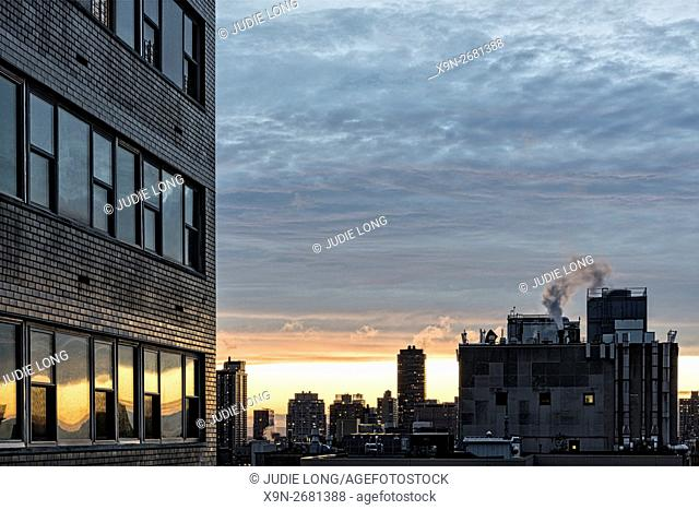 Cloudy Sunset Seen from the Upper East Side of Manhattan, New York City