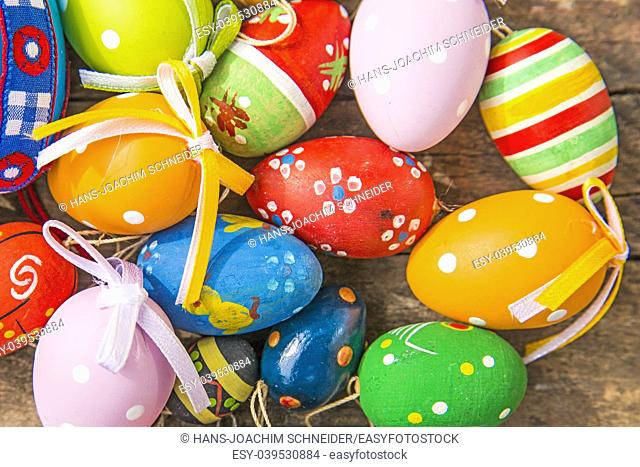 painted easter eggs on a plank