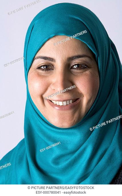 Portrait of a happy Arabic Muslim Woman