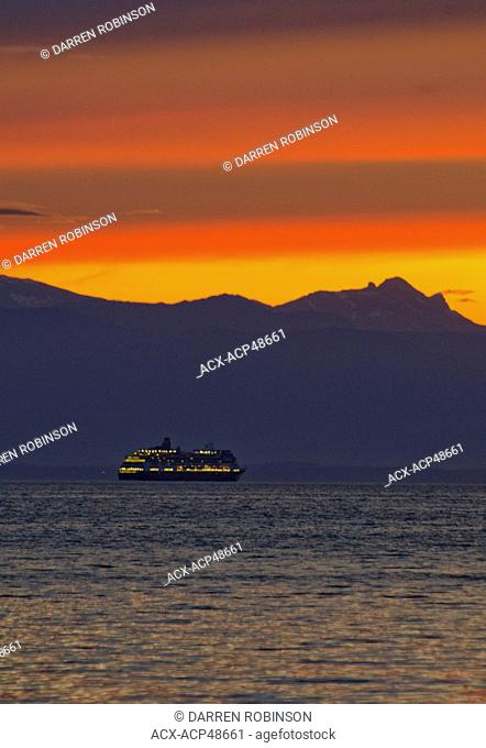 A cruise ship passes in front of Vancouver Island. Taken from Shelter Point on Texada Island, on British Columbia's Sunshine Coast, in the Vancouver