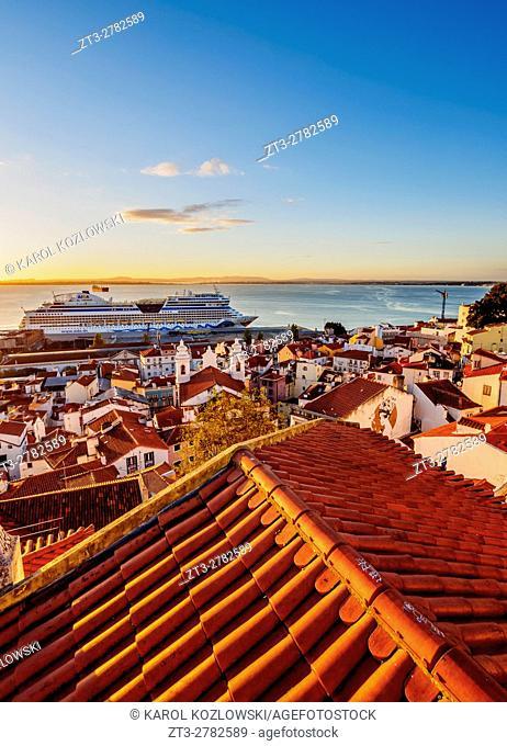 Portugal, Lisbon, Miradouro das Portas do Sol, View over Alfama Neighbourhood towards the Tagus River at sunrise