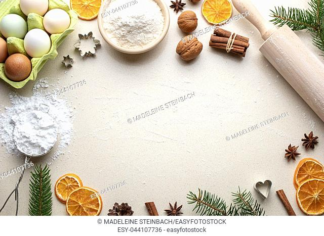 Ingredients for Christmas baking on a beige background with copy space