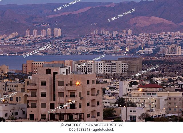 Jordan, Aqaba, elevated city view towards Eilat , Israel, dawn