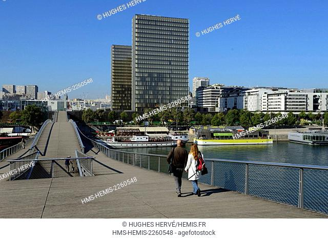 France, Paris, Bibliotheque Nationale de France (National Library of France) by architect Dominique Perrault seen from the Simone de Beauvoir footbridge by...