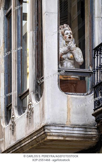 Sculptures in a window in the Born district in Barcelona, Catalonia, Spain