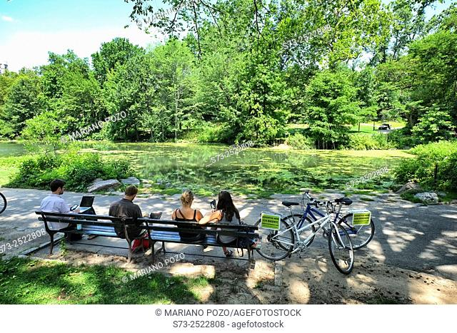 People sitting at the lakeside, Central Park, Manhattan, New York City, New York State