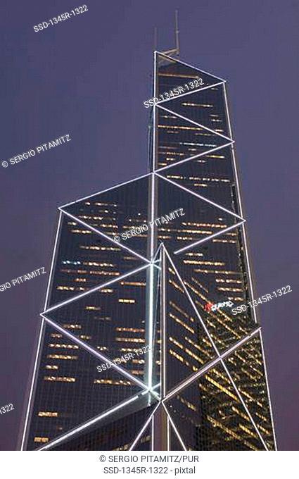 Low angle view of a bank building lit up at night, Bank of China Tower, Hong Kong, China