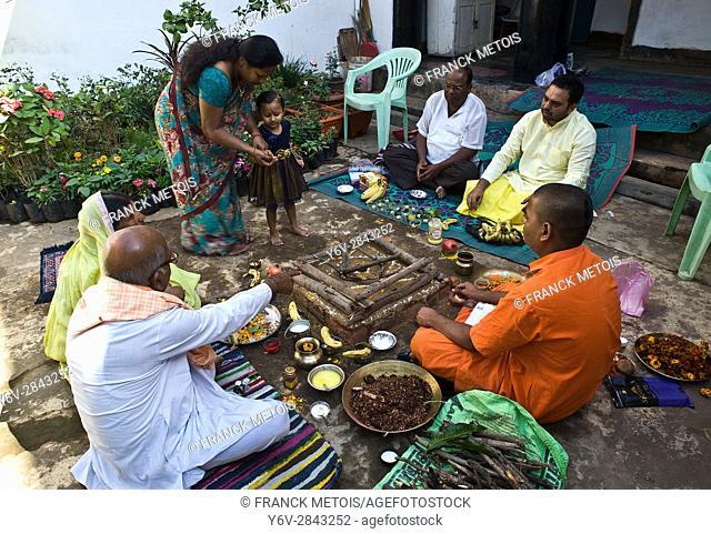 Hindu family and priests performing a yagna ritual at Kondagaon ( Chhattisgarh state, India)