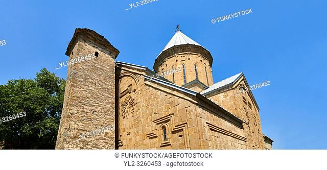 Pictures & images of the Church of the Assumption built in 1689. and a a tower with a stepped pyramidal roof of Svanetian type