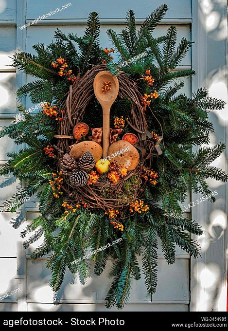 Christmas decoration on the bakery in Colonial Williamsburg Virginia, wreath includes bakers wares and tools