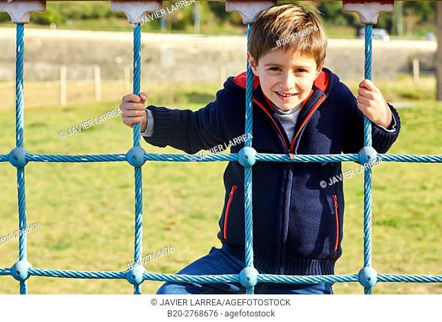 Boy playing in a playground, Zumaia, Gipuzkoa, Basque Country, Spain