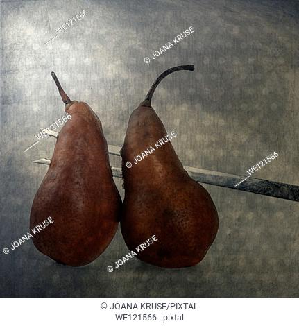 two pears, pierced on a big fork