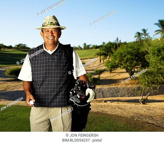 Hispanic man on golf course