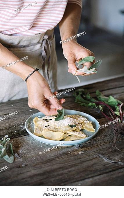 Filled ravioli on plate, sage